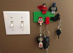 Batman and Robin are monitoring the key storing situation. Wonder Woman has seen better days.
